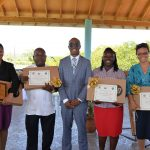 Executive Director of the Tourism Product Development Company (TPDCo), Dr Andrew Spencer (centre) stands proudly with happy winners of the Treasure Beach Recycling Competition at their awards presentation on Wednesday, May 16. The awards were presented at BREDS Sports Park. From left are: Opal Alexander, Principal of first place winner Sandy bank Primary School;  Wilton Smith, Principal of Pedro Plains Primary School which placed second;  Dr Spencer; Idenisha Foster-Day, Head of Department, Pedro Plains Infant School and Vennette Walker, Principal of Little Fish Basic School which placed third and fourth respectively.