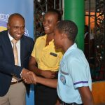 Executive Director of the Tourism Product Development Company (TPDCo), Dr. Andrew Spencer engage students In conversation at the TPDCo Tourism Youth Expo and Career Fair. The students who came from high schools in the Hanover and Westmoreland regions were sensitized on tourism and its many career possibilities.