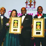 Minister of Tourism (centre) Honourable Edmund Bartlett poses with the 2018 Tourism Service Excellence Awards National Champion for the Individual category, Half Moon Hotel's Training Manager, Conroy Thompson (right) and Half Moon Hotel for the organization category represented by Brand and Communications Manager Laura Redpath. He is joined by (left) Executive Director of the Tourism Product Development Company, Dr. Andrew Spencer
