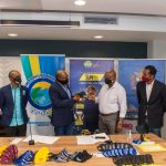 Tourism Minister, Hon. Edmund Bartlett (3rd left), presents President of the Jamaica Union of Travellers Association (JUTA), Noel Williams, with masks for members of the organization. They are among the frontline workers who will benefit from the 10,000 masks being provided as part of safeguards against the novel Coronavirus Disease 2019 (COVID-19) when the industry, which was impacted by the pandemic, reopens. The presentation was made at the Ministry's offices in New Kingston, on Friday (May 29). Others (from left) are: Director for the Tourism Linkages Network, Carolyn McDonald-Riley; Executive Director, Tourism Product Development Company (TPDCo), Dr. Andrew Spencer; Executive Director, Tourism Enhancement Fund (TEF), Dr. Carey Wallace; and Permanent Secretary in the Tourism Ministry, Jennifer Griffith.