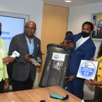 Tourism Minister, Hon. Edmund Bartlett (2nd L) examined a touchless hand sanitizer that will be part of the 500 tourism protective kits that will be distributed to SMTEs. Sharing in the moment are (from l-r) Permanent Secretary in the Ministry of Tourism, Jennifer Griffith, Executive Director of the Tourism Enhancement Fund, Dr. Carey Wallace and Director of the Tourism Linkages Network, Carolyn McDonald-Riley. The kits will include infrared thermometers, touchless hand sanitizers and touchless garbage bins.